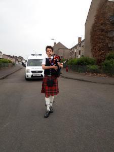 Piper leading walking parade